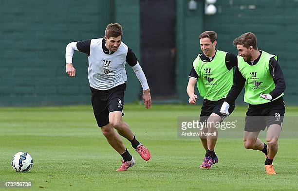 Steven Gerrard Joe Allen and Fabio Borini of Liverpool in action during a training session at Melwood Training Ground on May 14 2015 in Liverpool...