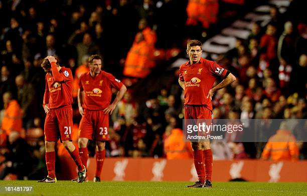 Steven Gerrard Lucas Leiva and Jamie Carragher of Liverpool look dejected during the Barclays Premier League match between Liverpool and West...