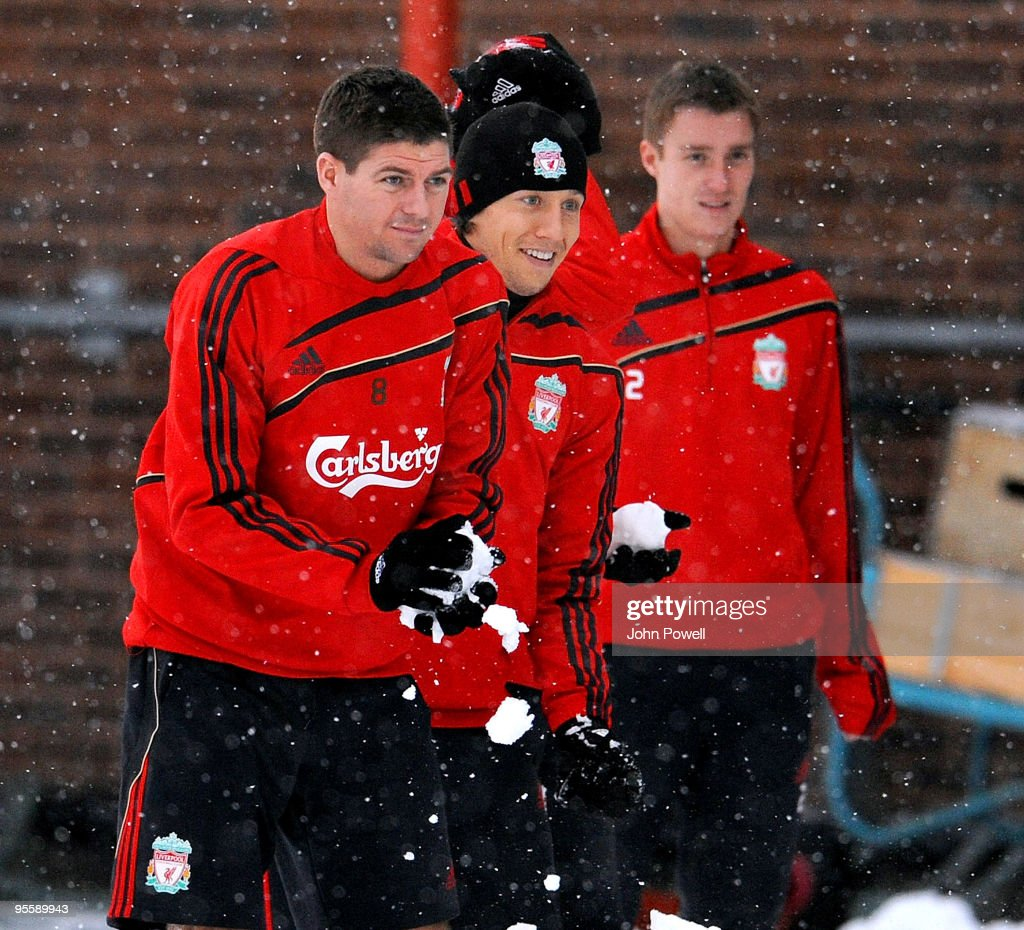 <a gi-track='captionPersonalityLinkClicked' href=/galleries/search?phrase=Steven+Gerrard&family=editorial&specificpeople=202052 ng-click='$event.stopPropagation()'>Steven Gerrard</a>, Lucas Leiva and <a gi-track='captionPersonalityLinkClicked' href=/galleries/search?phrase=Stephen+Darby&family=editorial&specificpeople=677119 ng-click='$event.stopPropagation()'>Stephen Darby</a> play in the snow during a training session at Melwood Training Ground on January 5, 2010 in Liverpool, England.