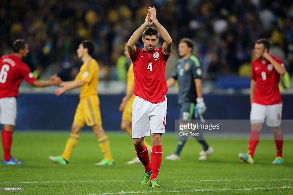<a gi-track='captionPersonalityLinkClicked' href=/galleries/search?phrase=Steven+Gerrard&family=editorial&specificpeople=202052 ng-click='$event.stopPropagation()'>Steven Gerrard</a> of England applauds the travelling fans following the 0-0 draw during the FIFA 2014 World Cup Qualifying Group H match between Ukraine and England at the Olympic Stadium on September 10, 2013 in Kiev, Ukraine.
