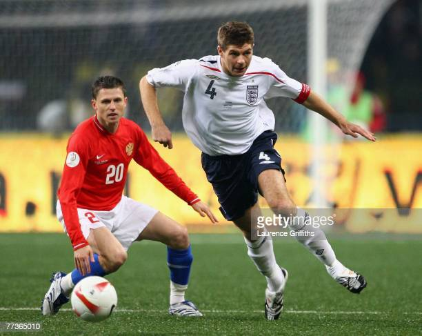 Steven Gerrard of England battles with Igor Semshov of Russia during the Euro 2008 qualifying match between Russia and England at The Luzhniki...