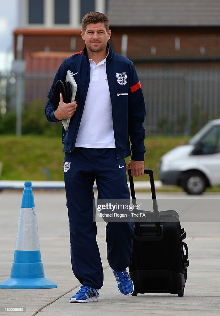<a gi-track='captionPersonalityLinkClicked' href=/galleries/search?phrase=Steven+Gerrard&family=editorial&specificpeople=202052 ng-click='$event.stopPropagation()'>Steven Gerrard</a> of England boards the plane to Kiev after the England press conference at Luton Airport on September 8, 2013 in Hertford, England.