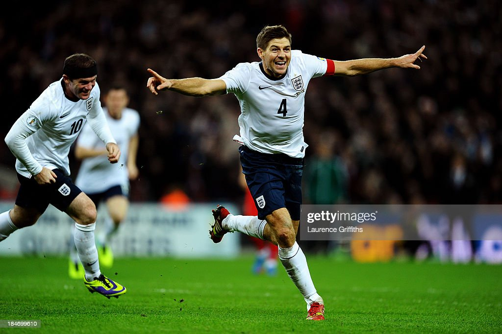 <a gi-track='captionPersonalityLinkClicked' href=/galleries/search?phrase=Steven+Gerrard&family=editorial&specificpeople=202052 ng-click='$event.stopPropagation()'>Steven Gerrard</a> of England celebrates as he scores their second goal during the FIFA 2014 World Cup Qualifying Group H match between England and Poland at Wembley Stadium on October 15, 2013 in London, England.