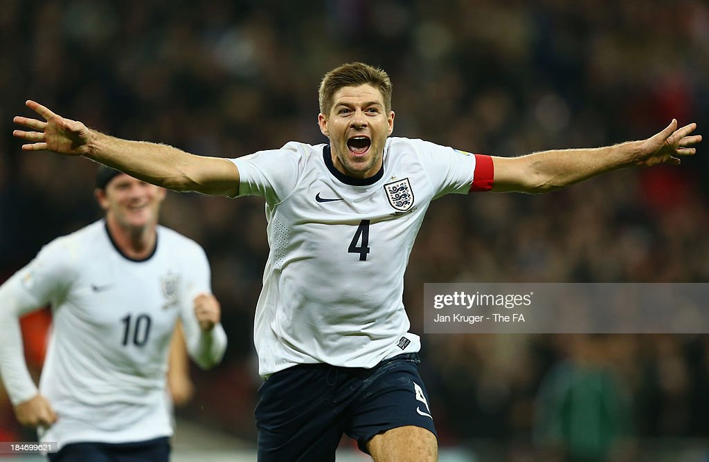<a gi-track='captionPersonalityLinkClicked' href=/galleries/search?phrase=Steven+Gerrard&family=editorial&specificpeople=202052 ng-click='$event.stopPropagation()'>Steven Gerrard</a> of England celebrates scoring their second goal during the FIFA 2014 World Cup Qualifying Group H match between England and Poland at Wembley Stadium on October 15, 2013 in London, England.