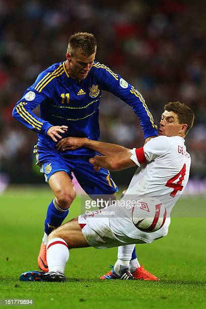 Steven Gerrard of England clashes with Andriy Yarmolenko of Ukraine during the FIFA 2014 World Cup Group H qualifying match between England and...