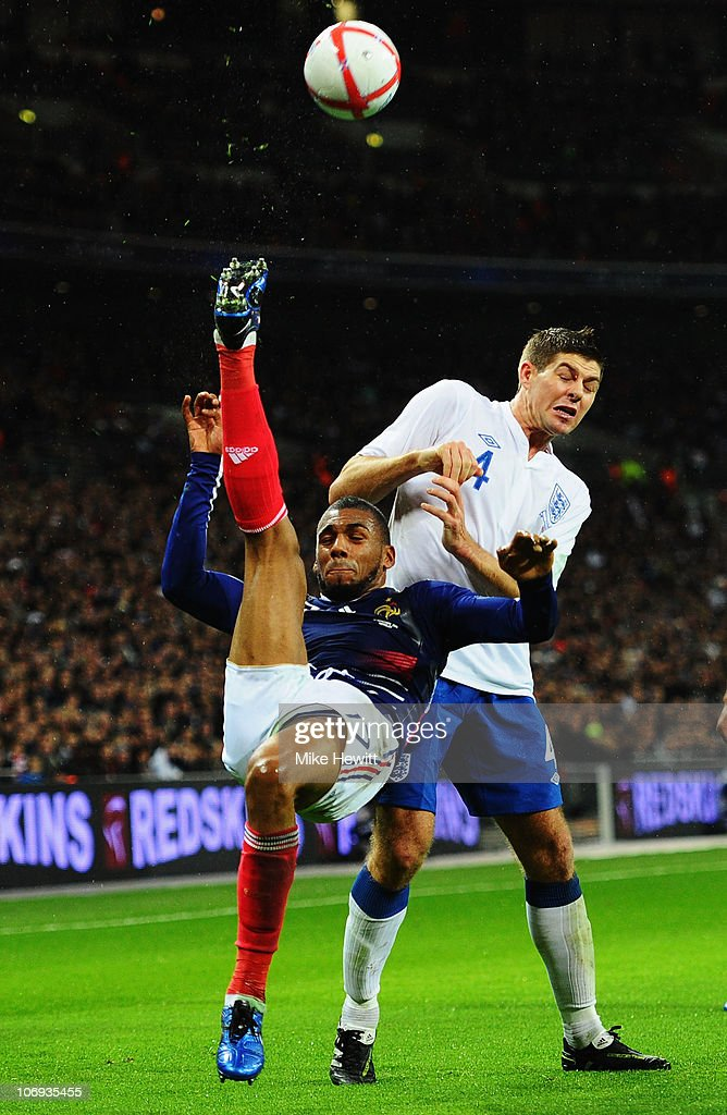 Steven Gerrard of England is beaten to the ball by Yann M'Vila of France during the international friendly match between England and France at Wembley Stadium on November 17, 2010 in London, England.
