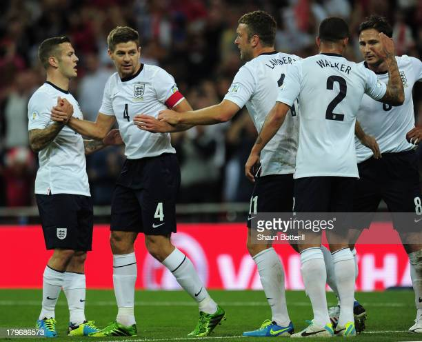 Steven Gerrard of England is congratulated by Jack Wilshere of England on scoring the opening goal during the FIFA 2014 World Cup Qualifying Group H...