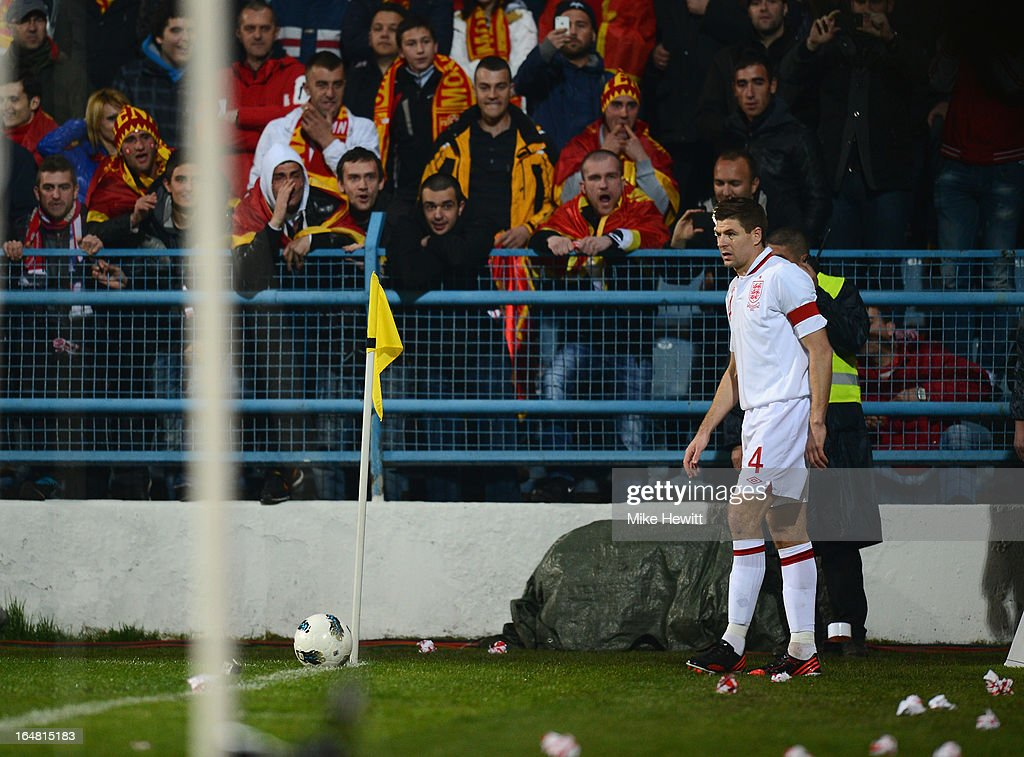 Steven Gerrard of England is taunted by Montenegran fans as he prepares to take the corner that led to Wayne Rooney's goal during the FIFA 2014 World Cup Group H Qualifier between Montenegro and England at City Stadium on March 26, 2013 in Podgorica, Montenegro.