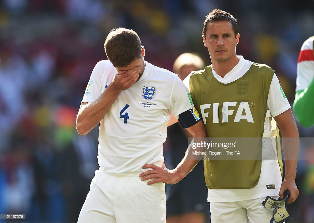 Steven Gerrard of England reacts and is consoled by teammate Phil Jagielka during the 2014 FIFA World Cup Brazil Group D match between Costa Rica and England at Estadio Mineirao on June 24, 2014 in Belo Horizonte, Brazil.