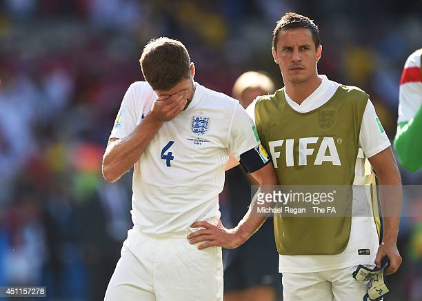 Steven Gerrard of England reacts and is consoled by teammate Phil Jagielka during the 2014 FIFA World Cup Brazil Group D match between Costa Rica and...