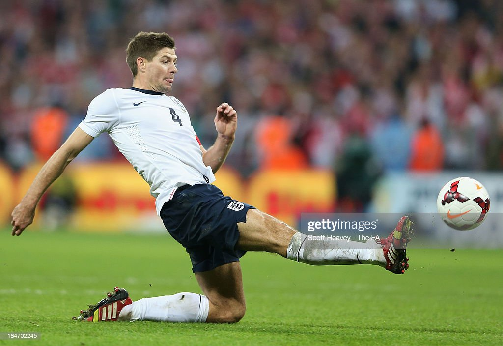<a gi-track='captionPersonalityLinkClicked' href=/galleries/search?phrase=Steven+Gerrard&family=editorial&specificpeople=202052 ng-click='$event.stopPropagation()'>Steven Gerrard</a> of England scores their second goal during the FIFA 2014 World Cup Qualifying Group H match between England and Poland at Wembley Stadium on October 15, 2013 in London, England.