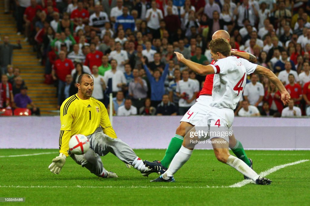 <a gi-track='captionPersonalityLinkClicked' href=/galleries/search?phrase=Steven+Gerrard&family=editorial&specificpeople=202052 ng-click='$event.stopPropagation()'>Steven Gerrard</a> of England shoots past goalkeeper Gabor Kiraly of Hungary to score his team's second goal during the International Friendly match between England and Hungary at Wembley Stadium on August 11, 2010 in London, England.