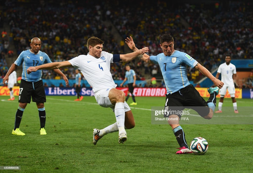 <a gi-track='captionPersonalityLinkClicked' href=/galleries/search?phrase=Steven+Gerrard&family=editorial&specificpeople=202052 ng-click='$event.stopPropagation()'>Steven Gerrard</a> of England tackles Cristian Rodriguez of Uruguay during the 2014 FIFA World Cup Brazil Group D match between Uruguay and England at Arena de Sao Paulo on June 19, 2014 in Sao Paulo, Brazil.