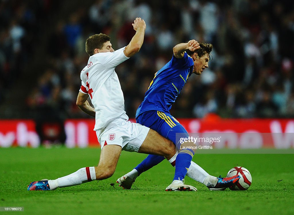 <a gi-track='captionPersonalityLinkClicked' href=/galleries/search?phrase=Steven+Gerrard&family=editorial&specificpeople=202052 ng-click='$event.stopPropagation()'>Steven Gerrard</a> (L) of England tackles <a gi-track='captionPersonalityLinkClicked' href=/galleries/search?phrase=Denys+Garmash&family=editorial&specificpeople=7150964 ng-click='$event.stopPropagation()'>Denys Garmash</a> of Ukraine and is sent off by match referee Cuneyt Cakir during the FIFA 2014 World Cup Group H qualifying match between England and Ukraine at Wembley Stadium on September 11, 2012 in London, England.