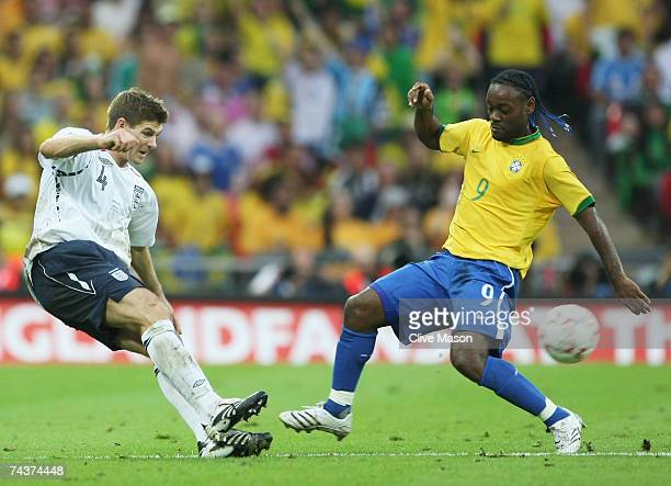 Steven Gerrard of England tackles Vagner Love of Brazil during the International Friendly match between England and Brazil at Wembley Stadium on June...