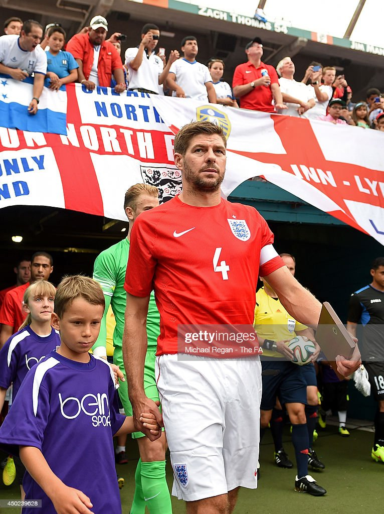 <a gi-track='captionPersonalityLinkClicked' href=/galleries/search?phrase=Steven+Gerrard&family=editorial&specificpeople=202052 ng-click='$event.stopPropagation()'>Steven Gerrard</a> of England walks onto the field with teammates before the International Friendly match between England and Honduras at Sun Life Stadium on June 7, 2014 in Miami Gardens, Florida.