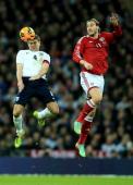 Steven Gerrard of England wins a header with Nicklas Bendtner of Denmark during the International Friendly match between England and Denmark at...