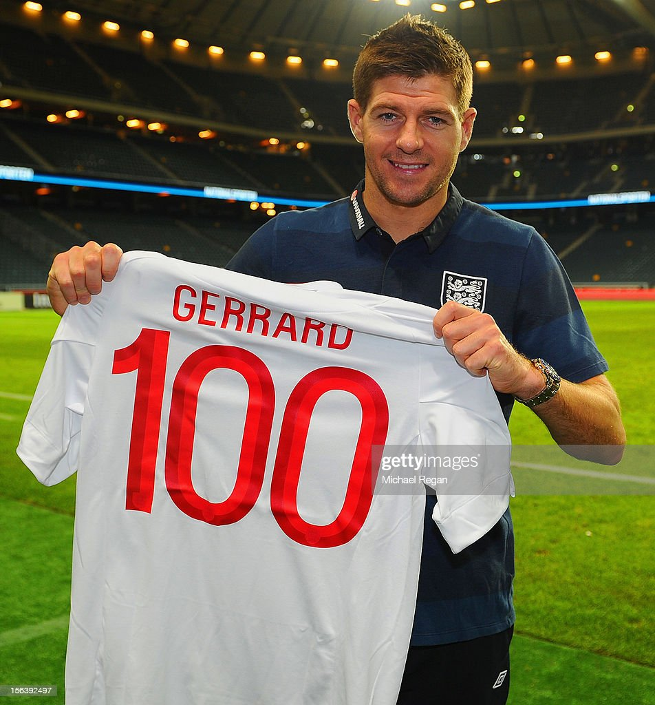 <a gi-track='captionPersonalityLinkClicked' href=/galleries/search?phrase=Steven+Gerrard&family=editorial&specificpeople=202052 ng-click='$event.stopPropagation()'>Steven Gerrard</a> of England with a shirt celebrating his 100th international cap after the international friendly match between Sweden and England at the Friends Arena on November 14, 2012 in Stockholm, Sweden.