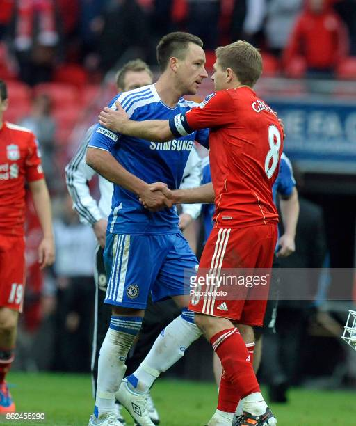 Steven Gerrard of Liverpool and John Terry of Chelsea shake hands after the FA Cup FInal at Wembley Stadium on May 05 2012 in London England