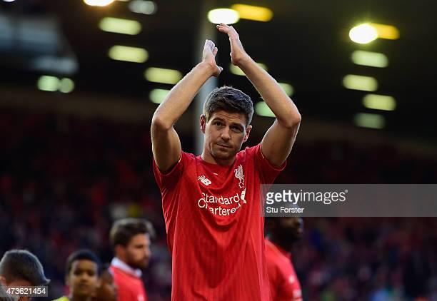 Steven Gerrard of Liverpool applauds the fans as he walks a lap of honour after his final game at Anfield during the Barclays Premier League match...