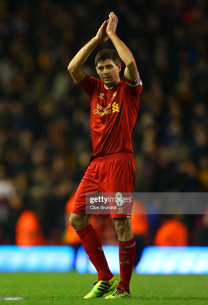 Steven Gerrard of Liverpool applauds the fans at the final whistle during the Barclays Premier League match between Liverpool and Hull City at Anfield on January 1, 2014 in Liverpool, England.