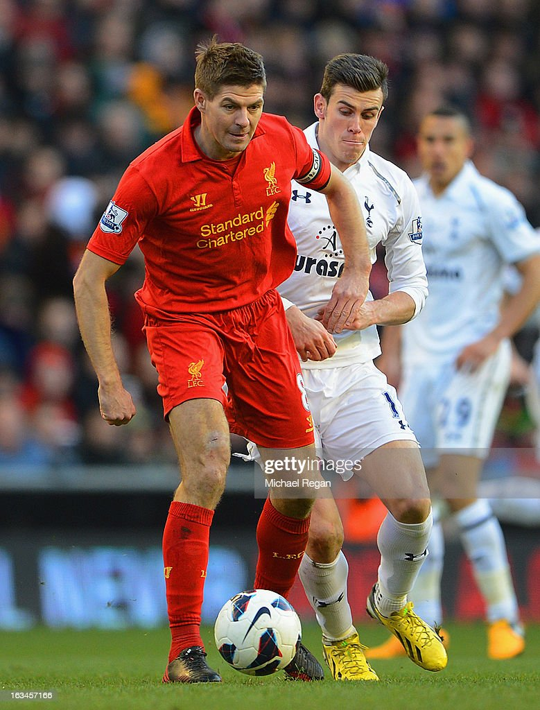 Steven Gerrard of Liverpool battles Gareth Bale of Tottenham during the Barclays Premier League match between Liverpool and Tottenham Hotspurs at Anfield on March 10, 2013 in Liverpool, England.