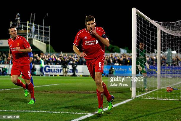 Steven Gerrard of Liverpool celebrates after scoring the opening goal with a header during the FA Cup Third Round match between AFC Wimbledon and...