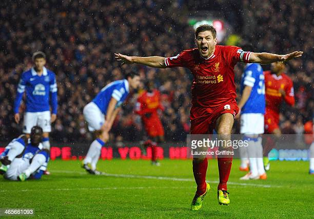Steven Gerrard of Liverpool celebrates after scoring the opening goal during the Barclays Premier League match between Liverpool and Everton at...