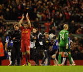 Steven Gerrard of Liverpool celebrates at the end of the Barclays Premier League match between Liverpool and Everton at Anfield on January 28 2014 in...