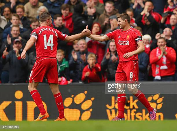 Steven Gerrard of Liverpool celebrates his goal with Jordan Henderson during the Barclays Premier League match between Liverpool and Queens Park...