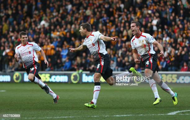 Steven Gerrard of Liverpool celebrates his goal with team mates Jordan Henderson and Jon Flanagan during the Barclays Premier League match between...
