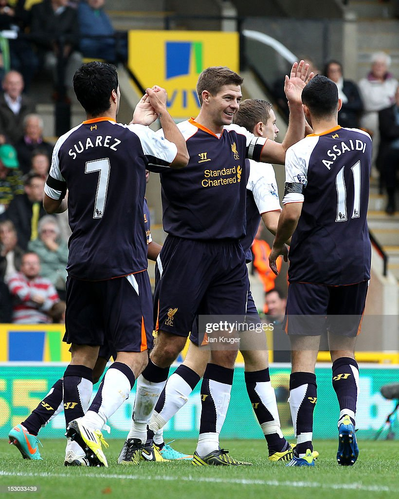 <a gi-track='captionPersonalityLinkClicked' href=/galleries/search?phrase=Steven+Gerrard&family=editorial&specificpeople=202052 ng-click='$event.stopPropagation()'>Steven Gerrard</a> of Liverpool celebrates his goal with team mates during the Barclays Premier League match between Norwich City and Liverpool at Carrow Road on September 29, 2012 in Norwich, England.
