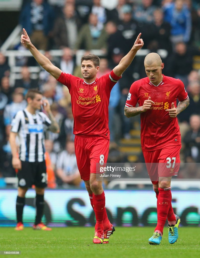<a gi-track='captionPersonalityLinkClicked' href=/galleries/search?phrase=Steven+Gerrard&family=editorial&specificpeople=202052 ng-click='$event.stopPropagation()'>Steven Gerrard</a> of Liverpool celebrates scoring from the penalty spot during the Barclays Premier League match between Newcastle United and Liverpool at St James' Park on October 19, 2013 in Newcastle upon Tyne, England.