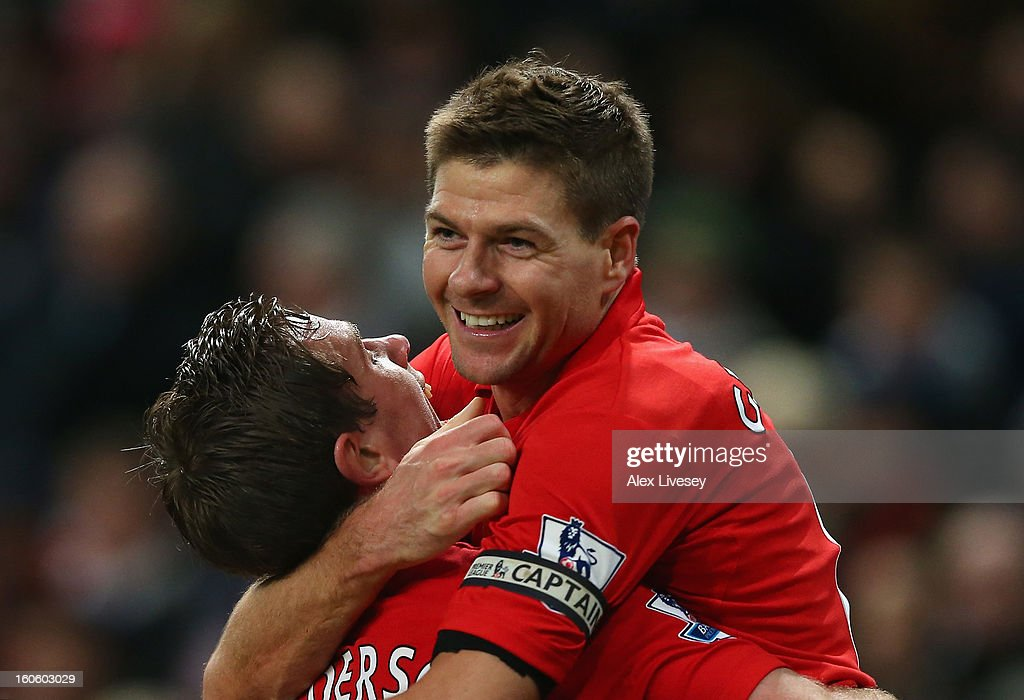 Steven Gerrard of Liverpool celebrates scoring his team's second goal with Jordan Henderson during the Barclays Premier League match between Manchester City and Liverpool at the Etihad Stadium on February 3, 2013 in Manchester, England.