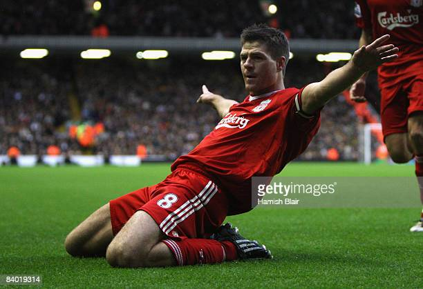 Steven Gerrard of Liverpool celebrates scoring his team's second goal during the Barclays Premier League match between Liverpool and Hull City at...
