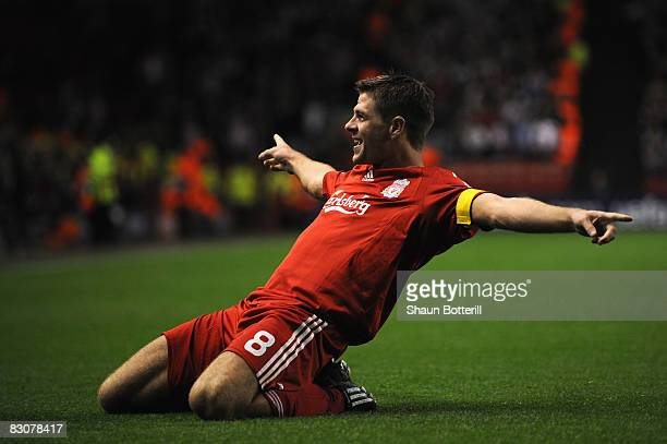 Steven Gerrard of Liverpool celebrates scoring his team's third goal and his 100th goal for Liverpool during the UEFA Champions League Group D match...