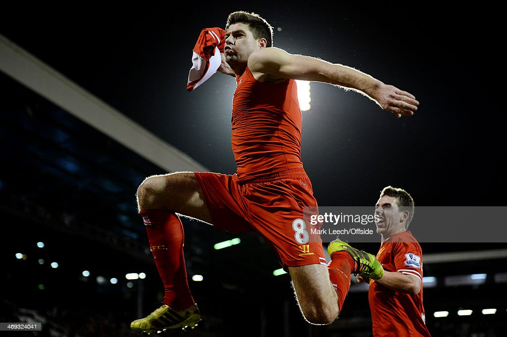 Steven Gerrard of Liverpool celebrates scoring the late winning goal from the penalty spot during the Premier League match between Fulham and...