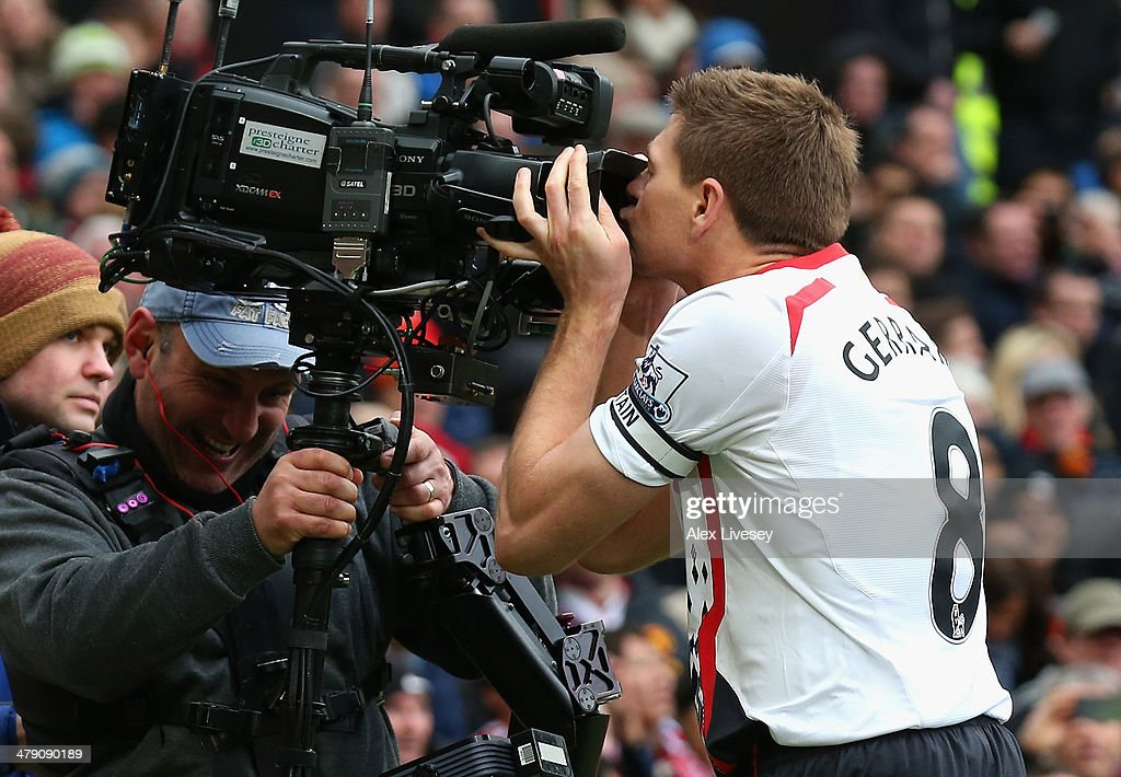 Steven Gerrard of Liverpool celebrates scoring the second goal by kissing the steadicam during the Barclays Premier League match between Manchester United and Liverpool at Old Trafford on March 16, 2014 in Manchester, England.