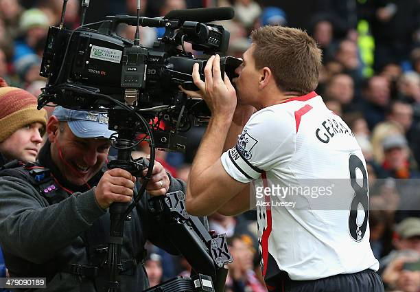 Steven Gerrard of Liverpool celebrates scoring the second goal by kissing the steadicam during the Barclays Premier League match between Manchester...