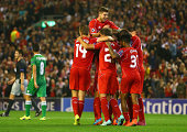 Steven Gerrard of Liverpool celebrates scoring the second goal from the penalty spot with team mates during the UEFA Champions League Group B match...