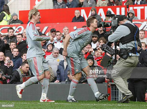 Steven Gerrard of Liverpool celebrates scoring their second goal during the Barclays Premier League match between Manchester United and Liverpool at...