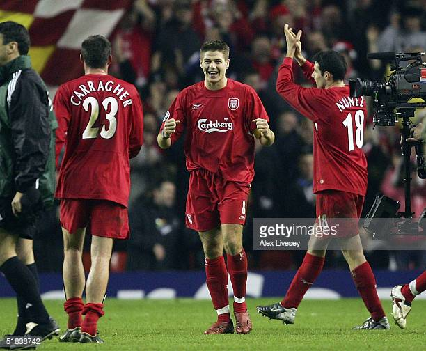 Steven Gerrard of Liverpool celebrates victory over Olympiakos with Jamie Carragher after the Champions League Group A match between Liverpool and...