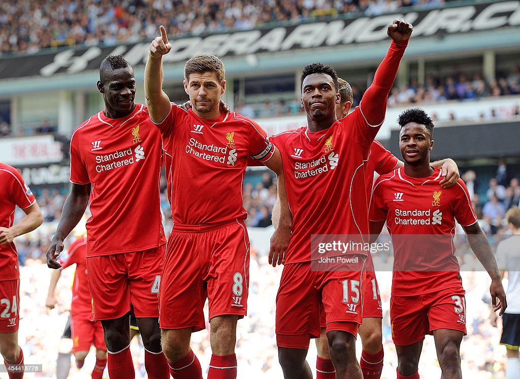 <a gi-track='captionPersonalityLinkClicked' href=/galleries/search?phrase=Steven+Gerrard&family=editorial&specificpeople=202052 ng-click='$event.stopPropagation()'>Steven Gerrard</a> of Liverpool celebrates with Daniel Sturridge and Mario Balotelli after scoring from the spot during the Barclays Premier League match between Tottenham Hotspur and Liverpool at White Hart Lane on August 31, 2014 in London, England.