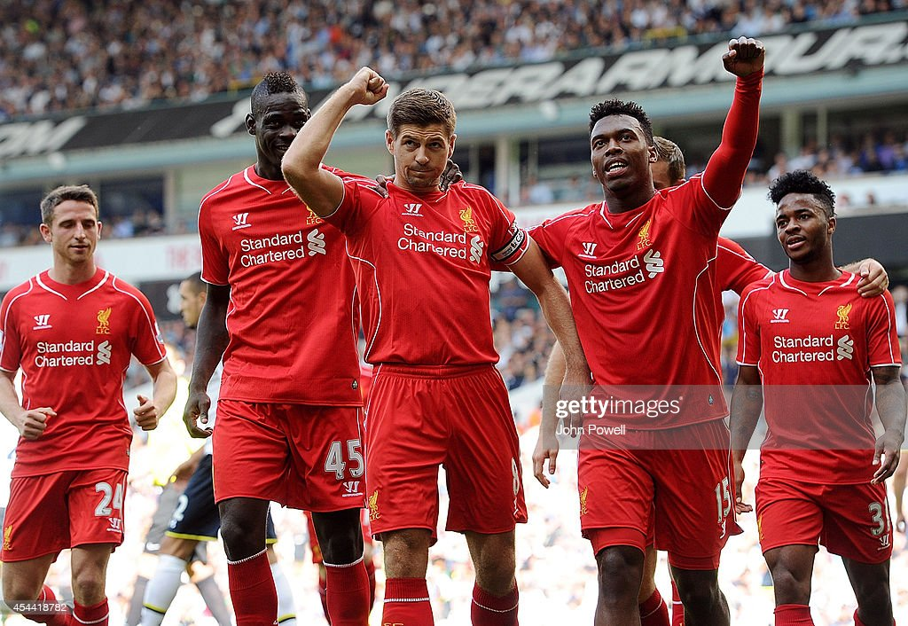 Steven Gerrard of Liverpool celebrates with Daniel Sturridge and Mario Balotelli after scoring from the spot during the Barclays Premier League match between Tottenham Hotspur and Liverpool at White Hart Lane on August 31, 2014 in London, England.