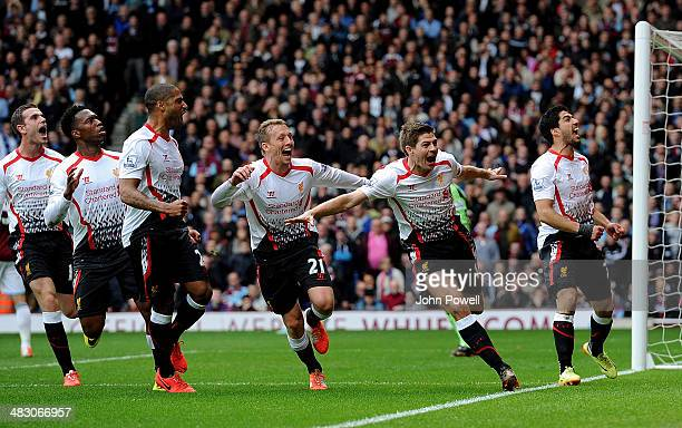 Steven Gerrard of Liverpool celebrates with his teammates after scoring the second goal from the penalty spot during the Barclays Premier League...