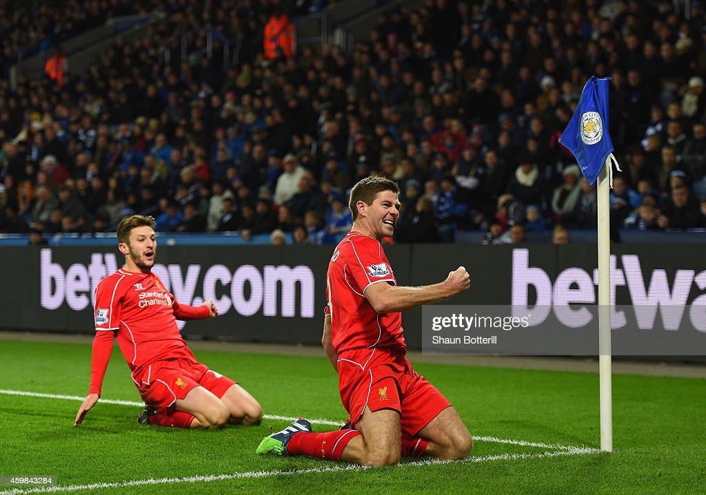 Steven Gerrard of Liverpool celebrates with teammate Adam Lallana of Liverpool after scoring his team's second goal during the Barclays Premier League match between Leicester City and Liverpool at The King Power Stadium on December 2, 2014 in Leicester, England.