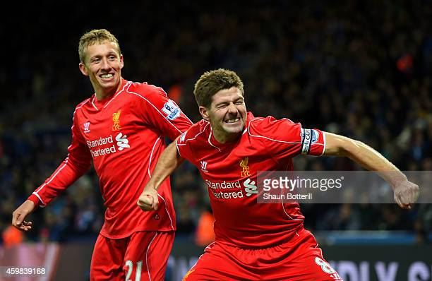Steven Gerrard of Liverpool celebrates with teammate Lucas Leiva of Liverpool after scoring his team's second goal during the Barclays Premier League...