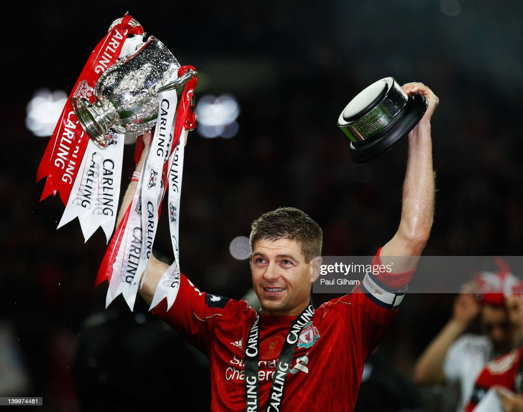 <a gi-track='captionPersonalityLinkClicked' href=/galleries/search?phrase=Steven+Gerrard&family=editorial&specificpeople=202052 ng-click='$event.stopPropagation()'>Steven Gerrard</a> of Liverpool celebrates with the trophy after victory in the Carling Cup Final match between Liverpool and Cardiff City at Wembley Stadium on February 26, 2012 in London, England. Liverpool won 3-2 on penalties.