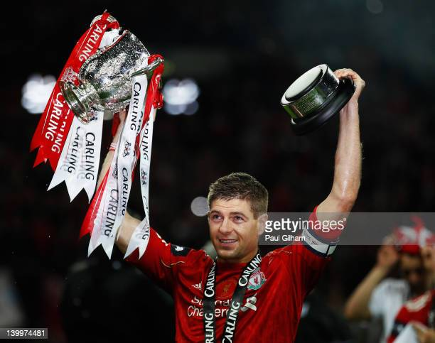 Steven Gerrard of Liverpool celebrates with the trophy after victory in the Carling Cup Final match between Liverpool and Cardiff City at Wembley...