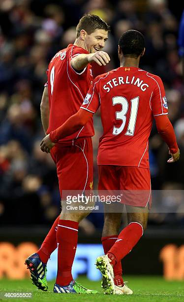 Steven Gerrard of Liverpool celebrateswith teammate Raheem Sterling of Liverpool after scoring his team's second goal from the penalty spot during...